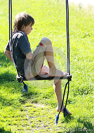 Wet boy on a swing