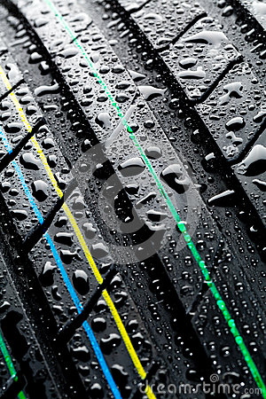 Wet car tire - thread pattern closeup