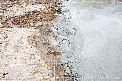Wet cement concrete