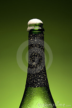 Wet Champagne bottle close-up