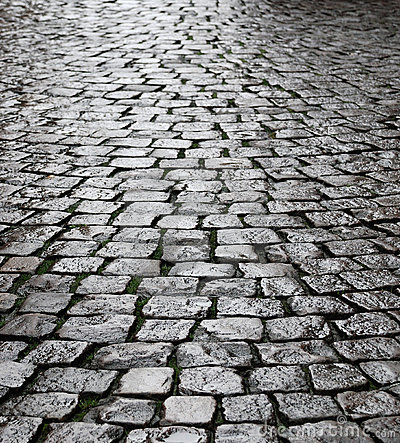 Wet cobbles of block pavement