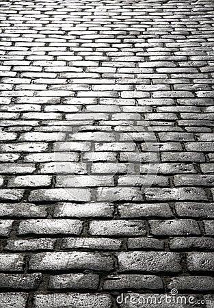 Wet cobblestones.