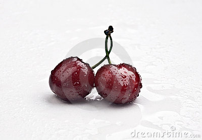 Wet crimson cherries