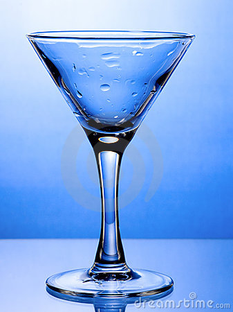 Wet empty martini glass