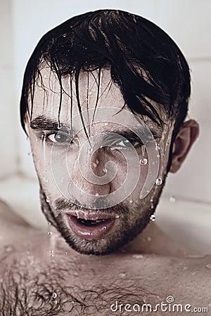 Wet face men in the shower