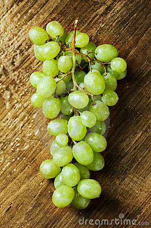 Wet grapes on a wooden table