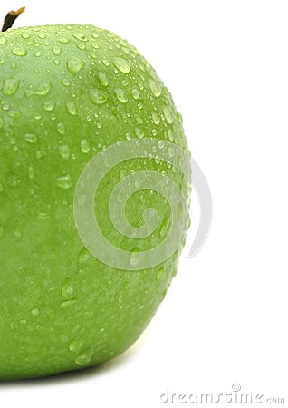 Wet green apple closeup