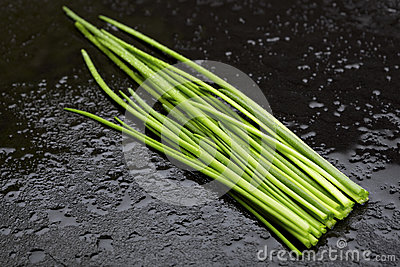 Wet green chives