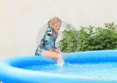 Wet little girl getting into pool