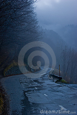Wet mountain road at dusk