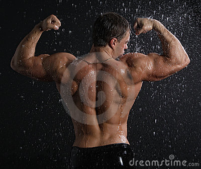 Wet muscle sexy young man back under the rain