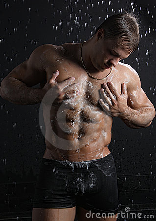 Wet muscle sexy young man take a shower