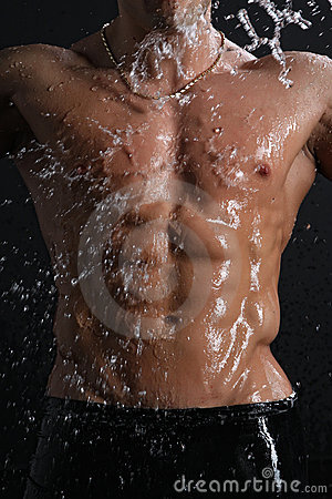 Wet muscle sexy young man torso under the rain