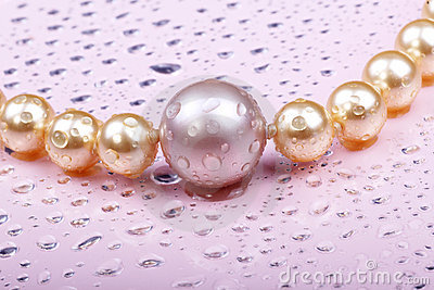 Wet pearls on pink