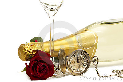 Wet red rose under a champagne bottle with a old p