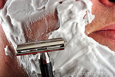 wet shaving razor and some foam in a face