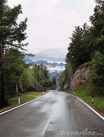 Wet shiny road in the Swiss Alps