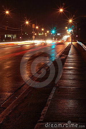 Wet street and light trail