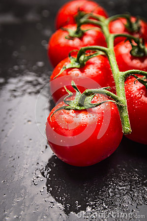 Free Wet Tomatoes Branch On Black Slate Background Royalty Free Stock Photography - 55675947
