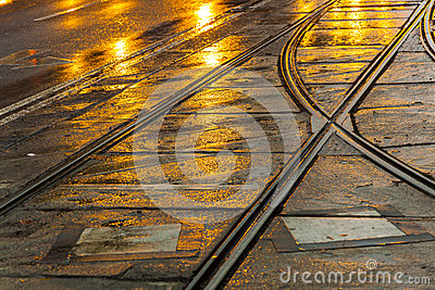 Wet trolley rails in the night