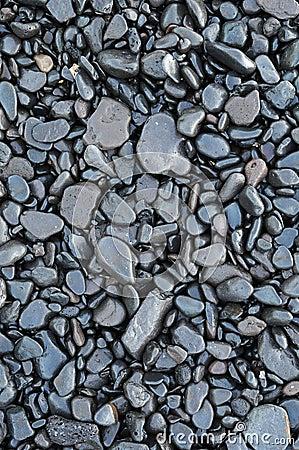 Wet waterworn pebbles