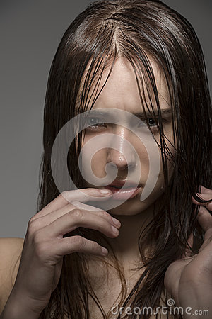 Wet woman with angry expression