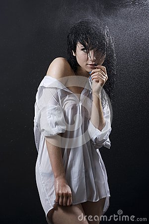 Wet woman wearing shirt