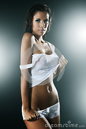 Wet woman wearing white tank top and panties