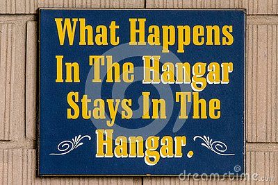 What happens in the hangar stays in the hangar sign Stock Photo