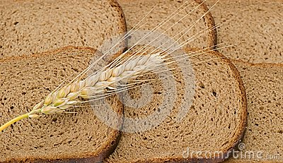Wheat ear laying on slices of bread