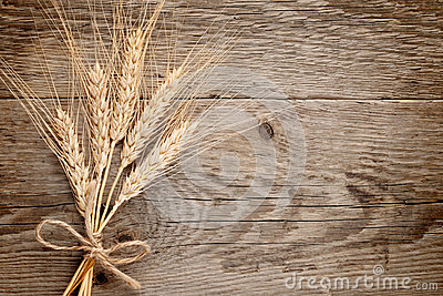 Wheat ears on wood