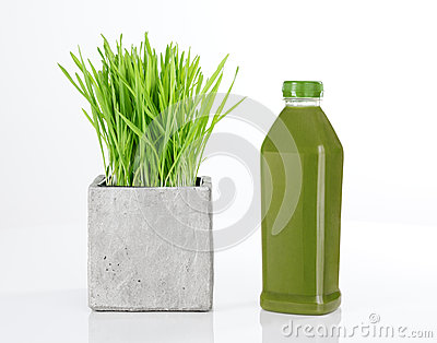 Wheatgrass and bottle of green juice