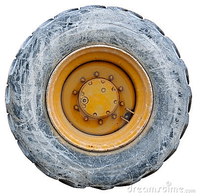 Wheel of backhoe or tractor - used - isolated