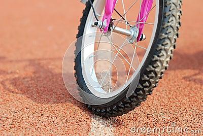 A wheel of bike on the runway