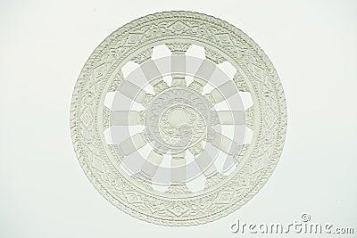 Wheel of dharma on glass
