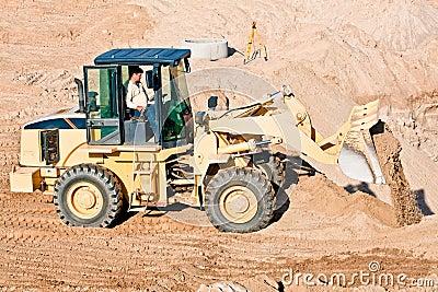 Wheel loader excavator unloading sand