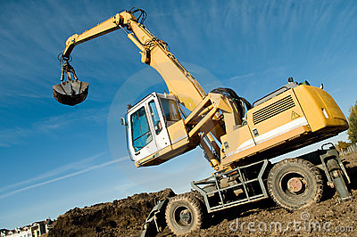 Wheel loader excavator at work