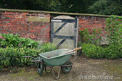 Wheelbarrow by gate