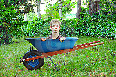 Image result for man in a wheelbarrow