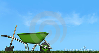 Wheelbarrow and shovel on grass
