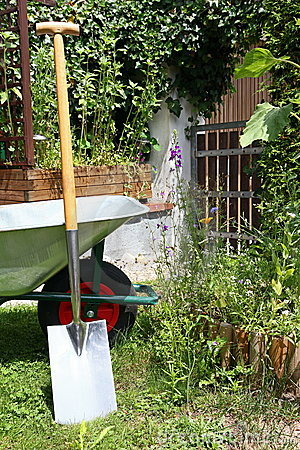 Wheelbarrow and spade