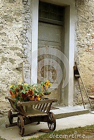 Free Wheelbarrow With Sunflowers Stock Photos - 2133783