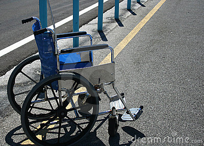 Wheelchair in parking lot