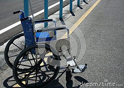 Wheelchair in parking lot