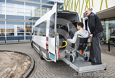 Wheelchair taxi pick up Stock Photo