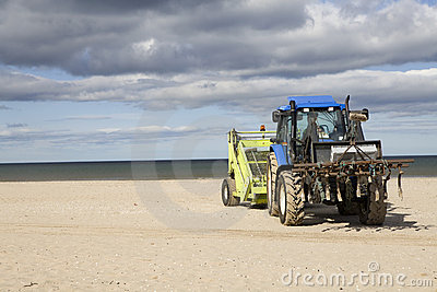 Wheeled tractor for cleaning sand on beach