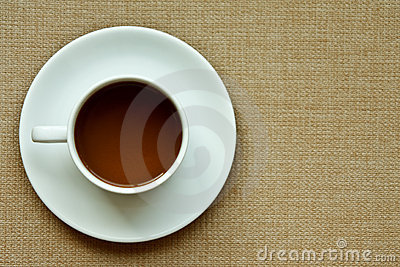 Whie coffee cup on cloth texture