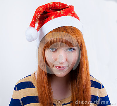 Whimsical girl in a New Year s cap