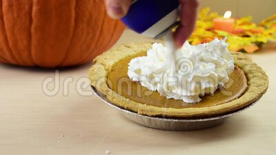 Whip cream on pumpkin pie stock footage