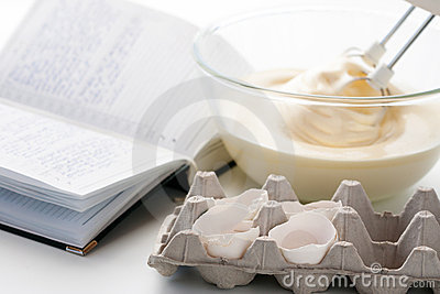 Whisk with eggs in a bowl